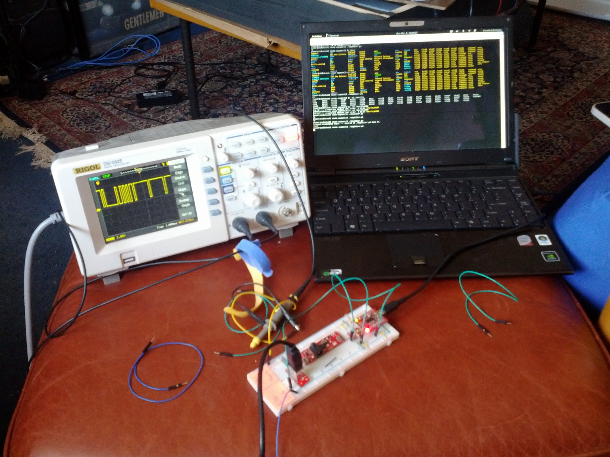 Here's the laptop next to my oscilloscope working on my large seven-segment display project.